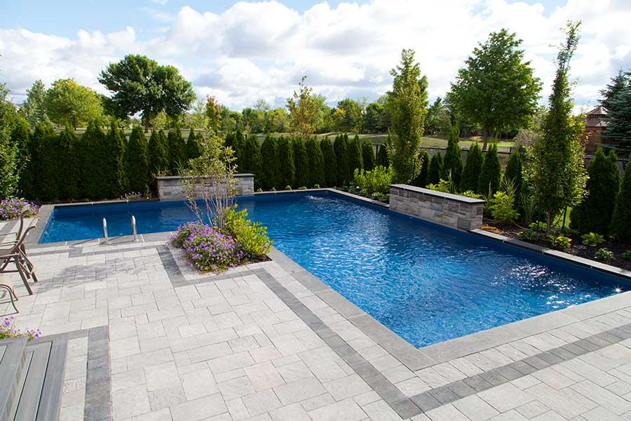 The dassanayakes inground pool pioneer family pools for Pool design hamilton