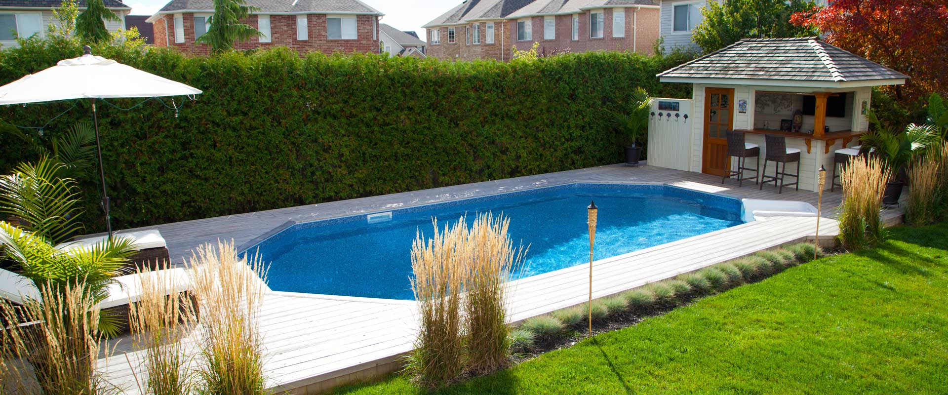 Above ground pool landscaping round swimming pools above for Pool design kitchener